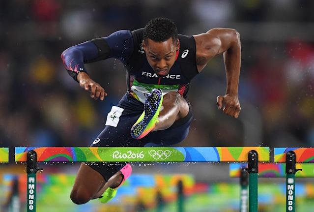<p>Dimitri Bascou of France competes during the Men's 110m Hurdles Round 1 – Heat 3 on Day 10 of the Rio 2016 Olympic Games at the Olympic Stadium on August 15, 2016 in Rio de Janeiro, Brazil. (Getty) </p>