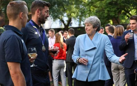 Britain's Prime Minister Theresa May with Liam Plunkett and Tom Curran - Credit: Yui Mok/PA