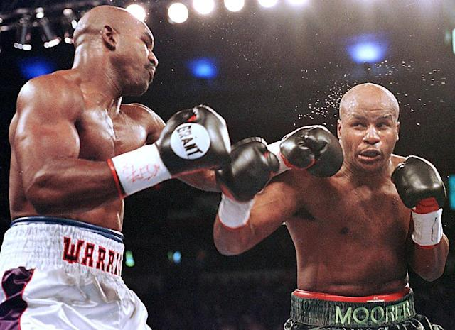 Michael Moorer (R) was 1-1 in two heavyweight title fights with Hall of Famer Evander Holyfield (L). (Getty Images)