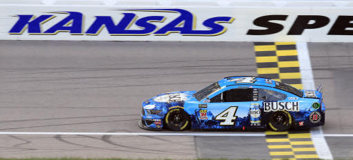 Kevin Harvick drives during qualifying for the NASCAR Cup Series auto race at Kansas Speedway in Kansas City, Kan., Friday, May 10, 2019. Harvick won the pole. (AP Photo/Orlin Wagner)