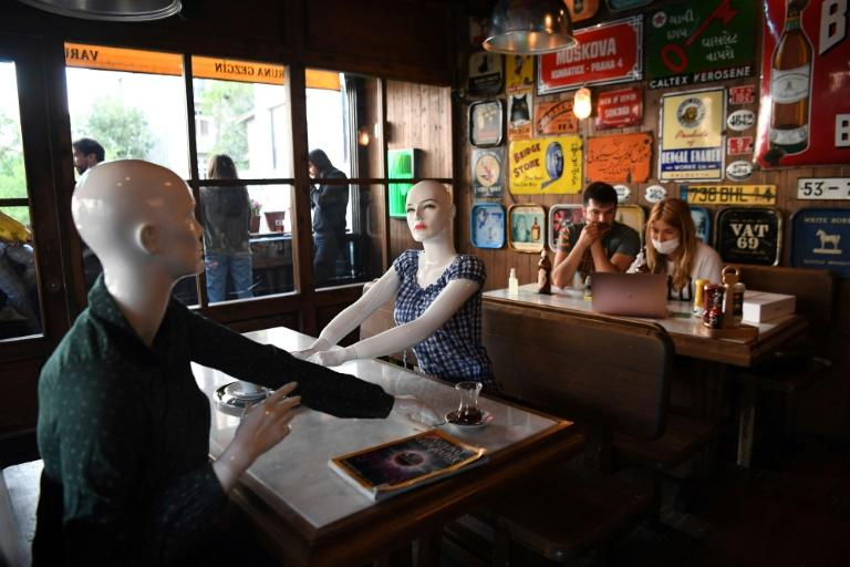 In one cafe near Istanbul's central Taksim square,mannequins set up at the tables encourage social distancing while making the establishment look busier than the rules allow