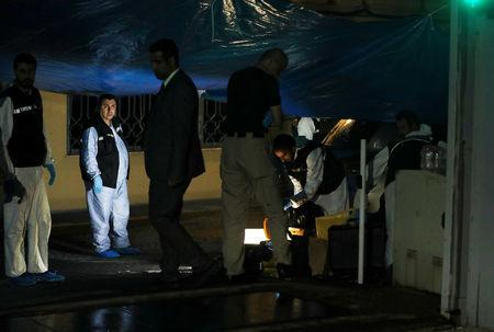 Turkish police forensic experts and Saudi officials are seen at the backyard of Saudi Arabia's consulate in Istanbul