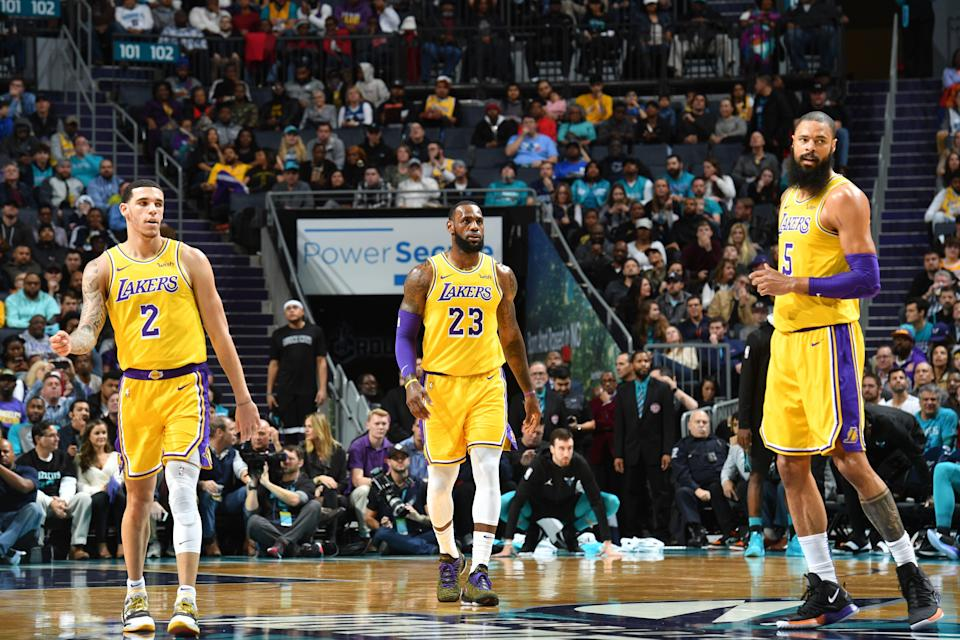 CHARLOTTE, NC - DECEMBER 15:  Lonzo Ball #2, Lebron James #23 and Tyson Chandler #5 of the Los Angeles Lakers look on during the game against the Charlotte Hornets on December 15, 2018 at Spectrum Center in Charlotte, North Carolina. NOTE TO USER: User expressly acknowledges and agrees that, by downloading and or using this photograph, User is consenting to the terms and conditions of the Getty Images License Agreement.  Mandatory Copyright Notice:  Copyright 2018 NBAE (Photo by Jesse D. Garrabrant/NBAE via Getty Images)