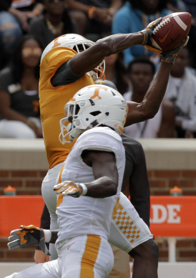 Orange team wide receiver Josh Palmer (5) makes a catch over White team defensive back Marquill Osborne (3) during the Orange and White spring game at Neyland Stadium on Saturday, April 21, 2018 in Knoxville, Tenn. (C.B. Schmelter /Chattanooga Times Free Press via AP)