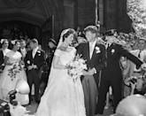 <p>Jackie's silk taffeta wedding gown with its portrait neckline for her marriage to John F. Kennedy was created by Ann Lowe, an African-American fashion designer. A crowd of 1,000 people awaited the couple as they exited the church in Newport, Rhode Island.<br></p>