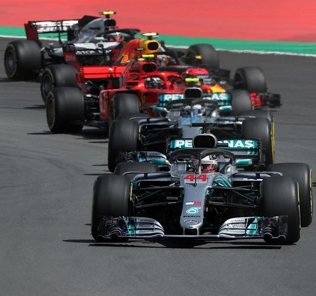 Formula One F1 - Spanish Grand Prix - Circuit de Barcelona-Catalunya, Barcelona, Spain - May 13, 2018 Mercedes' Lewis Hamilton leads Ferrari's Sebastian Vettel at the first corner during the race REUTERS/Albert Gea TPX IMAGES OF THE DAY