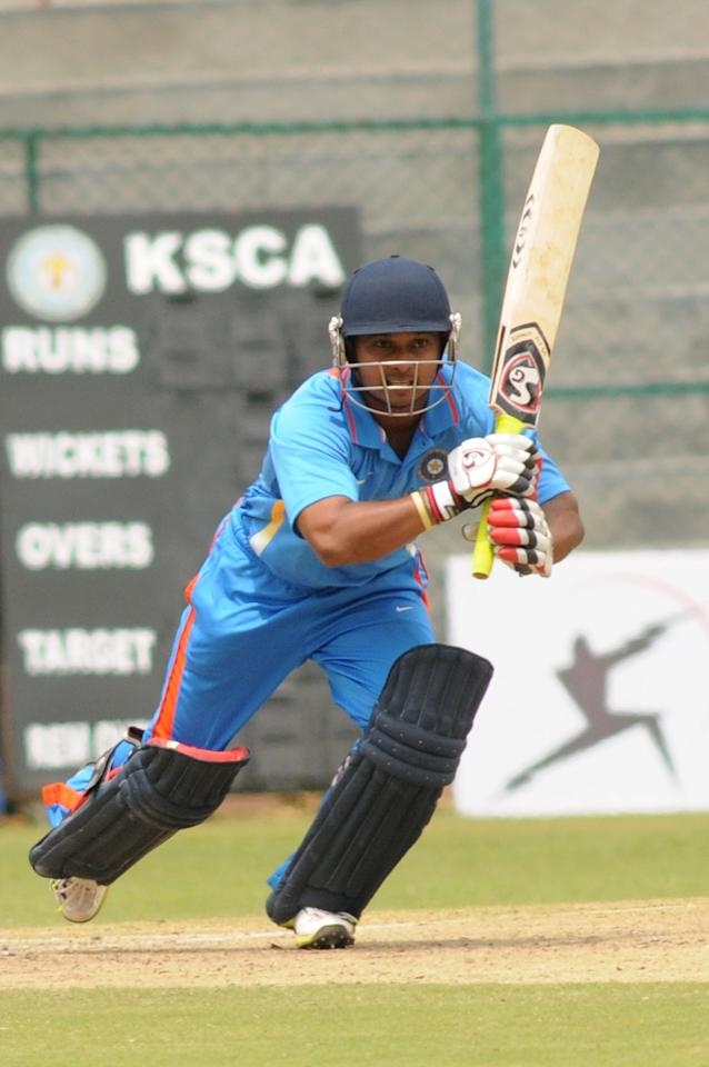 Indian A team Player KM Jadhav in action against West Indies A team, during  India A team v/s West Indies A team unofficial T-20 cricket match at Chinnaswamy Stadium, in Bangalore on Saturday 21st of Sept. 2013. (Photo: IANS)