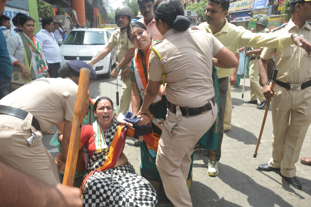 <p>Congress, NCP, Samajvadi Party, protest against fuel prices at Byclla Station. Police trying to maintain decorum during the protest in Mumbai, India. Yahoo India/Stringer </p>
