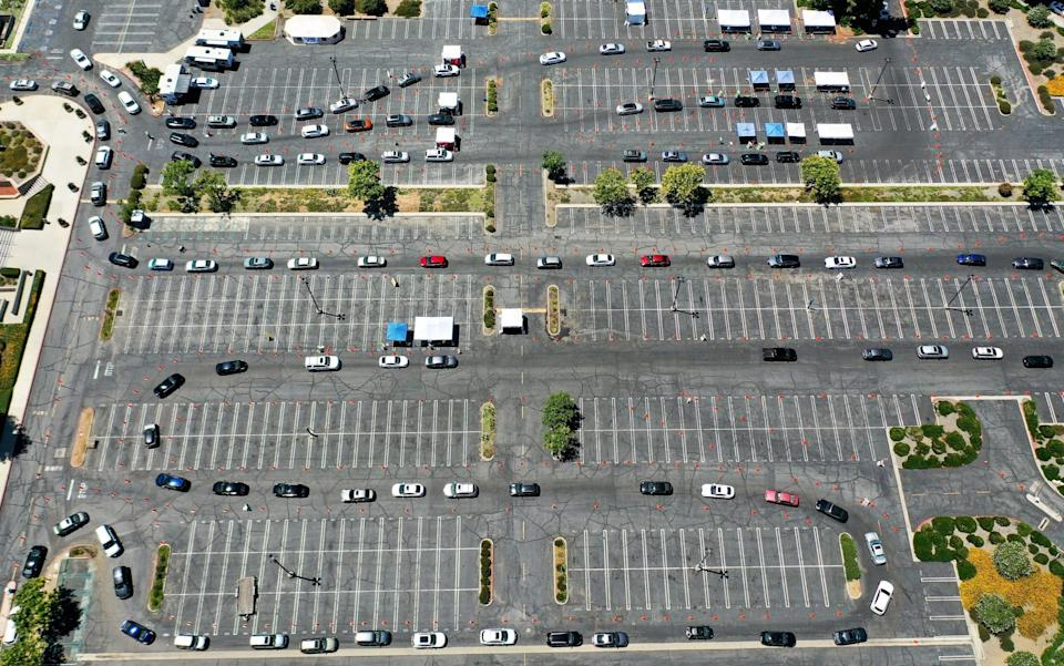 An aerial view of motorists lined up to be tested for Covid-19 in the Woodland Hills neighborhood amid the coronavirus pandemic - Mario Tama/Getty Images