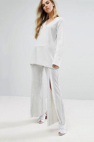 """<p>This breezy House of Sunny two-piece set has snaps running down the back of the tunic and the front of each flared pant leg, making it easy to switch up your silhouette—and how much skin you do, or don't, want to show—without actually changing clothes.<span></span></p><p><span>House of Sunny Tunic, $76, <a rel=""""nofollow"""" href=""""http://us.asos.com/house-of-sunny/house-of-sunny-popper-back-tunic-top-co-ord/prd/7462120?CTAref=Complete%20the%20Look%20Carousel_1&featureref1=complete%20the%20look""""><u>asos.com</u></a>; Wide Leg Pants, $83, <a rel=""""nofollow"""" href=""""http://us.asos.com/house-of-sunny/house-of-sunny-wide-leg-pants-with-popper-front-co-ord/prd/7462119?iid=7462119&clr=Stripe&SearchQuery=co-ord&pgesize=36&pge=1&totalstyles=168&gridsize=3&gridrow=1&gridcolumn=1""""><u>asos.com</u></a>.<span></span><br></span></p>"""
