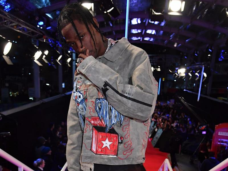 Travis Scott posed for photos at the EMAs but reportedly swerved fans questions. Source: Getty