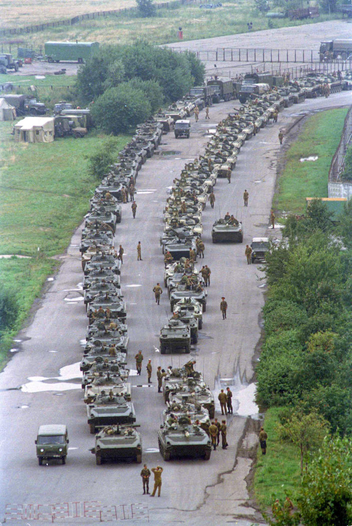 FILE - In this Tuesday, Aug. 20, 1991 file photo, a convoy of Soviet tanks holds its position near Moscow's central airfield less than two miles from the Kremlin, Russia. When a group of top Communist officials ousted Soviet leader Mikhail Gorbachev 30 years ago and flooded Moscow with tanks, the world held its breath, fearing a rollback on liberal reforms and a return to the Cold War confrontation. But the August 1991 coup collapsed in just three days, precipitating the breakup of the Soviet Union that plotters said they were trying to prevent. (AP Photo/Boris Yurchenko, File)