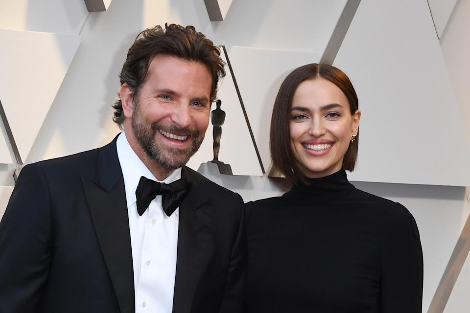 """Best Actor nominee for """"A Star is Born"""" Bradley Cooper (L) and his wife Russian model Irina Shayk arrive for the 91st Annual Academy Awards at the Dolby Theatre in Hollywood, California on February 24, 2019. (Photo by Mark RALSTON / AFP)        (Photo credit should read MARK RALSTON/AFP/Getty Images)"""