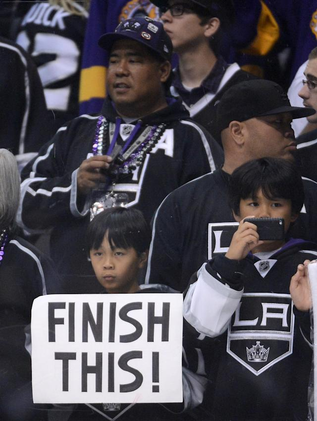 LOS ANGELES, CA - JUNE 11: Los Angeles Kings fans hold up a sign saying 'Finish This' before Game Six of the 2012 Stanley Cup Final against the New Jersey Devils at Staples Center on June 11, 2012 in Los Angeles, California. (Photo by Harry How/Getty Images)