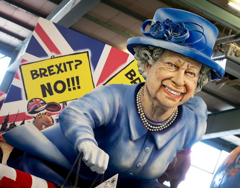 A figure depicting Queen Elizabeth is displayed during a press preview in a hall of the Mainz carnival club in Mainz, Germany, Feb. 26, 2019. (Photo: Michael Probst/AP)
