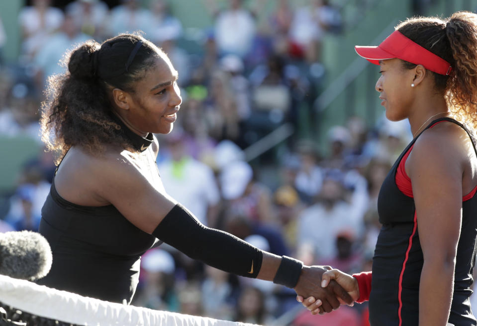 Naomi Osaka, right, of Japan, shakes hands with Serena Williams after winning their match at the Miami Open tennis tournament, Wednesday, March 21, 2018, in Key Biscayne, Fla. Osaka won 6-3, 6-2. (AP Photo/Lynne Sladky)