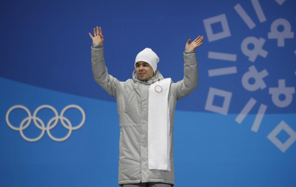 Semen Elistratov celebrates his bronze medal-winning performance. (Reuters)