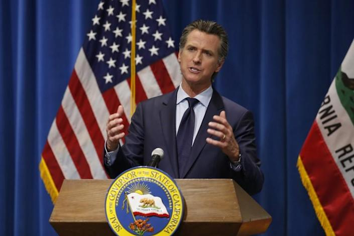 California Gov. Gavin Newsom discusses his revised 2020-2021 state budget during a news conference in Sacramento, Calif., Thursday, May 14, 2020. Reflecting the financial hit California is already seeing from the coronavirus, Newsom proposed cutting $6.1 billion from a variety of programs in a state budget he says prioritizes public education, public health and public safety. (AP Photo/Rich Pedroncelli, Pool)
