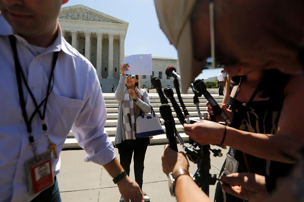 Television journalists prepare for a news conference on the plaza in front of the U.S. Supreme Court building on June 9, 2016.