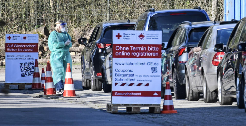 People wait in their cars for a COVID-19 rapid test at a Red Cross drive-in test center in Gelsenkirchen, Germany, Wednesday, March 31, 2021. (AP Photo/Martin Meissner)