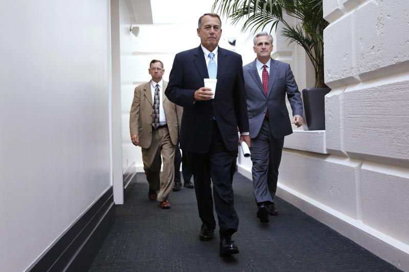 U.S. House Speaker John Boehner (R-OH) (C) and House Majority Whip Rep. Kevin McCarthy (R-CA) (R) arrive for a Republican caucus meeting at the U.S. Capitol in Washington, October 15, 2013. A month of combat in the U.S. Congress over government spending showed signs of giving way to a Senate deal to reopen shuttered federal agencies and prevent an economically damaging default on federal debt. REUTERS/Jonathan Ernst (UNITED STATES - Tags: POLITICS BUSINESS)