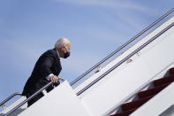 President Joe Biden recovers after stumbling while boarding Air Force One at Andrews Air Force Base, Md., Friday, March 19, 2021. Biden is en route to Georgia. (AP Photo/Patrick Semansky)