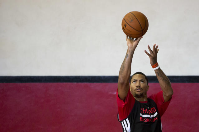 Chicago Bulls' Derrick Rose shoots during a practice session ahead of a NBA Global Games match against Washington Wizards in Rio de Janeiro, Brazil, Wednesday, Oct. 9, 2013. The Chicago Bulls will face Washington Wizards on Oct. 12 in the first-ever NBA game in Brazil. (AP Photo/Felipe Dana)
