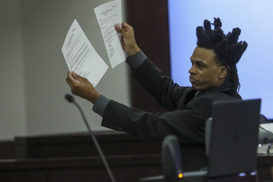 Ronnie Oneal III displays evidence while representing himself during closing arguments for his murder trial at the George E. Edgecomb Courthouse in Tampa, Fla., on Monday, June 21, 2021. (Ivy Ceballo/Tampa Bay Times via AP)
