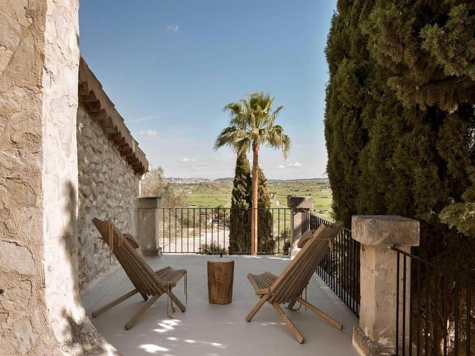 """<p>Located outside the hilltop village of Montuiri, around 20 minutes from Palma's airport, <a href=""""https://go.redirectingat.com?id=127X1599956&url=https%3A%2F%2Fwww.booking.com%2Fhotel%2Fes%2Ffinca-serena-mallorca.en-gb.html%3Faid%3D2070929%26label%3Dmallorca-hotels&sref=https%3A%2F%2Fwww.redonline.co.uk%2Ftravel%2Fg37570714%2Fmallorca-hotels%2F"""" rel=""""nofollow noopener"""" target=""""_blank"""" data-ylk=""""slk:Finca Serena"""" class=""""link rapid-noclick-resp"""">Finca Serena</a> is housed in a traditional rustic building that dates back to the 13th century and features 25 rooms and suites. The estate surrounding the hotel spreads over more than 40 hectares with over 800 olive trees, cypresses, lavender, lemon trees and pines. There are also 10 hectares of vines planted with autochthonous grapes, so that Finca Serena guests can sample Mallorcan wine.</p><p>The kitchen garden supplies the restaurant with fresh vegetables, fruits and herbs, and during your stay, you'll want to experience the Jacaranda Restaurant, the spa with indoor pool and large swimming pool with sunbathing terrace. Finca Serena's concept is to enjoy its natural environment and the panoramic views across El Pla (the central region of the island) and the Sierra Tramuntana Mountains. During your stay, you can try out various running and walking routes from and around the estate. </p><p><a class=""""link rapid-noclick-resp"""" href=""""https://go.redirectingat.com?id=127X1599956&url=https%3A%2F%2Fwww.booking.com%2Fhotel%2Fes%2Ffinca-serena-mallorca.en-gb.html%3Faid%3D2070929%26label%3Dmallorca-hotels&sref=https%3A%2F%2Fwww.redonline.co.uk%2Ftravel%2Fg37570714%2Fmallorca-hotels%2F"""" rel=""""nofollow noopener"""" target=""""_blank"""" data-ylk=""""slk:CHECK AVAILABILITY"""">CHECK AVAILABILITY</a></p>"""