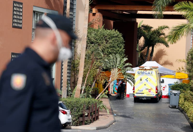 People are seen in H10 Costa Adeje Palace area, which is on lockdown after cases of coronavirus have been detected there in Adeje