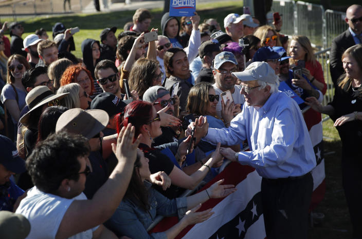 2020 Democratic presidential candidate Sen. Bernie Sanders, right, meets with supporters at a rally Saturday, March 16, 2019, in Henderson, Nev. (AP Photo/John Locher)