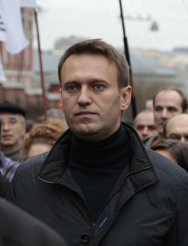 FILE - In this Sunday, Oct. 27, 2013 file photo Russian opposition leader Alexei Navalny takes part in an opposition rally in downtown Moscow. Russia's anti-corruption campaigner Navalny on Monday, Jan. 27, 2014, launched a website to publish a wide range of data pointing to corruption in Sochi. Russia has spent about $51 billion to deliver the Winter Olympics in Sochi, which run Feb. 7-23. (AP Photo/Ivan Sekretarev, File)