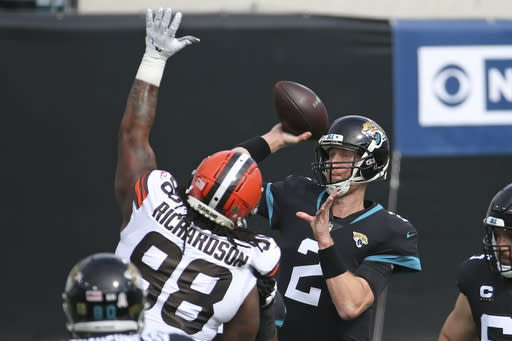 Jacksonville Jaguars quarterback Mike Glennon (2) throws a pass over Cleveland Browns defensive tackle Sheldon Richardson (98) during the first half of an NFL football game, Sunday, Nov. 29, 2020, in Jacksonville, Fla. (AP Photo/Stephen B. Morton)