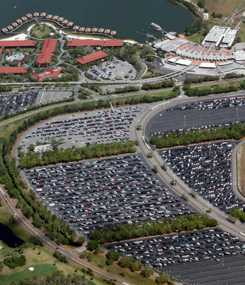 A nearly full parking lot outside the transportation hub at Disney's Magic Kingdom on the final day before closing in an effort to combat the spread of coronavirus disease (COVID-19), in an aerial view in Orlando, Florida, U.S. March 15, 2020. Picture taken March 15, 2020. REUTERS/Gregg Newton