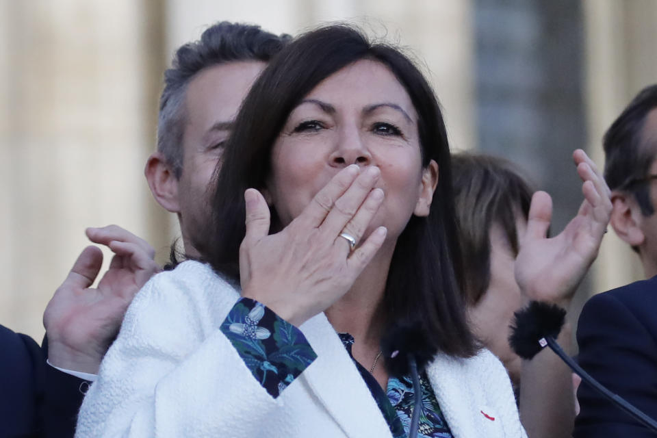 Paris mayor Anne Hidalgo blows a kiss to the audience after her victorious second round of the municipal election, Sunday, June 28, 2020 in Paris. France on Sunday held the second round of municipal elections that has seen a record low turnout amid concerns over the coronavirus outbreak and anger at how President Emmanuel Macron's government handled it. (AP Photo/Christophe Ena)