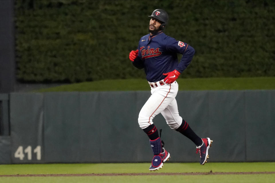 Minnesota Twins' Byron Buxton rounds the bases on a three-run home run off Toronto Blue Jays pitcher Jose Berrios in the third inning of a baseball game, Friday, Sept. 24, 2021, in Minneapolis. (AP Photo/Jim Mone)
