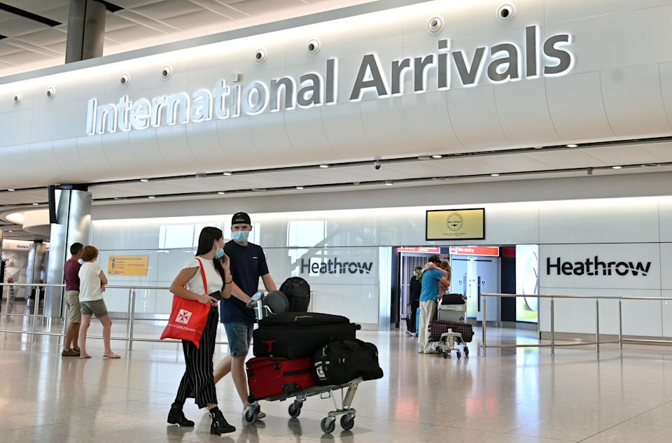 <p>All travellers coming into the UK will have to quarantine for at least five days</p> (AFP via Getty Images)