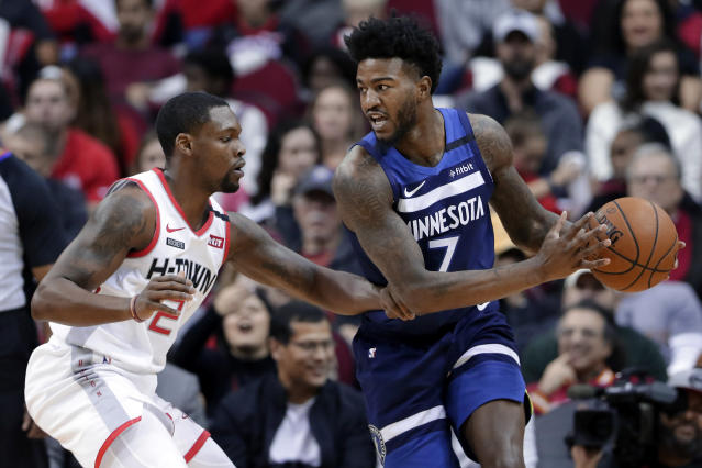 Minnesota Timberwolves forward Jordan Bell (7) looks to drive around Houston Rockets guard Michael Frazier, left, during the second half of an NBA basketball game Saturday, Jan. 11, 2020, in Houston. (AP Photo/Michael Wyke)
