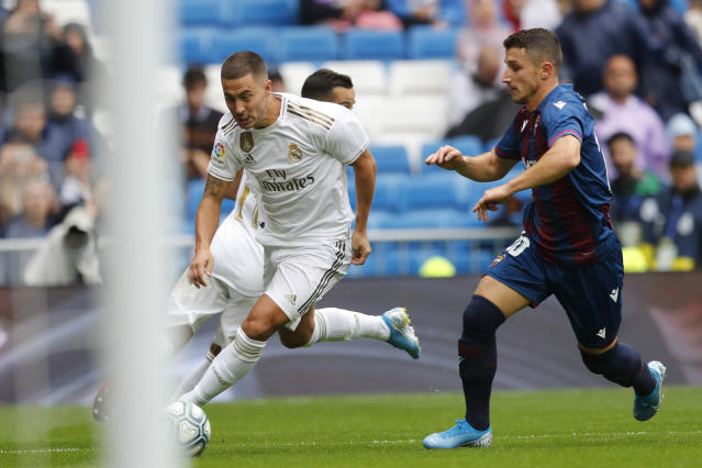 Real Madrid's Eden Hazard, left, vies for the ball with Levante's Enis Bardhi during the Spanish La Liga soccer match between Real Madrid and Levante at the Santiago Bernabeu stadium in Madrid, Spain, Saturday, Sept. 14, 2019. (AP Photo/Bernat Armangue)