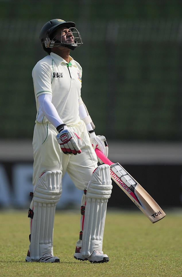 Bangladesh cricket captain Mushfiqur Rahim leaves the field after being dismissed by West Indies cricketer Tino Best during the fifth day of the first cricket Test match between Bangladesh and The West Indies at the Sher-e-Bangla National Cricket Stadium in Dhaka on November 17, 2012.  AFP PHOTO/ Munir uz ZAMAN