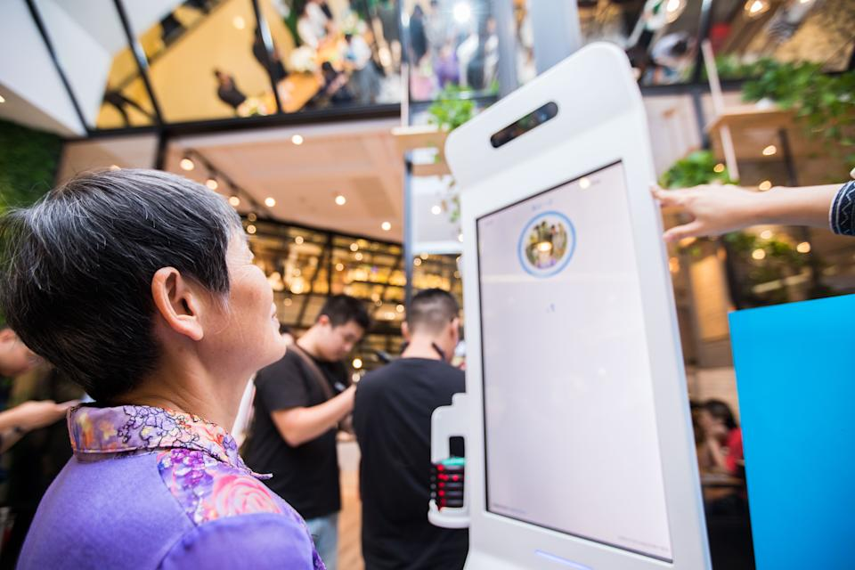 HANGZHOU, CHINA - SEPTEMBER 01:  A customer purchases goods via Alipay which could collect money through recognizing customers' identity at KFC's KPRO restaurant on September 1, 2017 in Hangzhou, Zhejiang Province of China. Alipay uses face recognition system to collect money when customers take commodities to pass through a payment gateway.  (Photo by Visual China Group via Getty Images/Visual China Group via Getty Images)