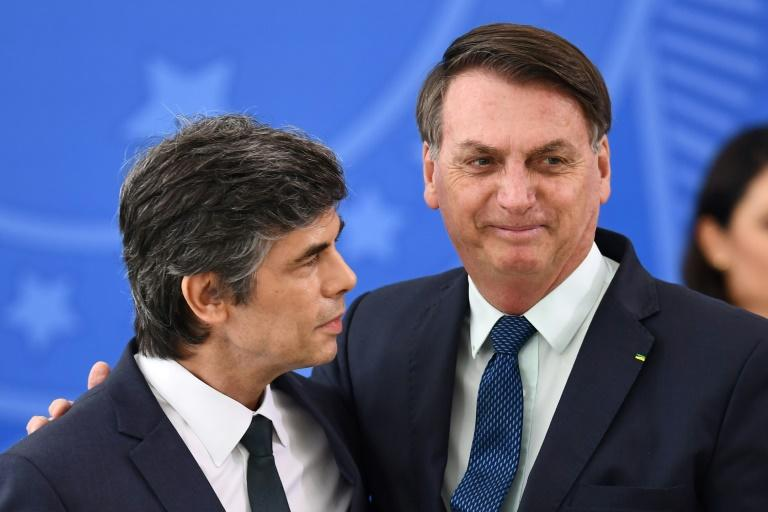 Brazilian Health Minister Nelson Teich (left, with President Jair Bolsonaro) joined the cabinet on April 17, 2020 (AFP Photo/EVARISTO SA)
