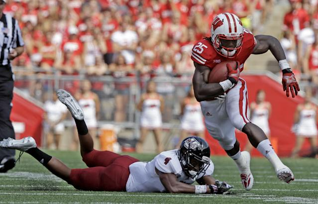 Wisconsin's Melvin Gordon, right, breaks away from Massachusetts's Randall Jette (4) during the first half of an NCAA college football game Saturday, Aug. 31, 2013, in Madison, Wis. (AP Photo/Morry Gash)