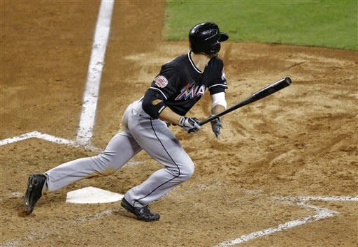 Miami Marlins' Bryan Petersen follows through on an RBI single against the Arizona Diamondbacks during the sixth inning of a baseball game, Tuesday, Aug. 21, 2012, in Phoenix. (AP Photo/Matt York)