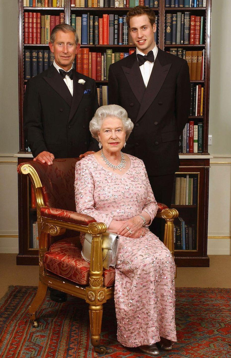 <p>Queen Elizabeth II sits in front of her son Prince Charles (second in line for the throne) and Prince William (third in line for the throne) at the 50th anniversary of her coronation. The photo was taken at Clarence House, Charles' official residence.</p>