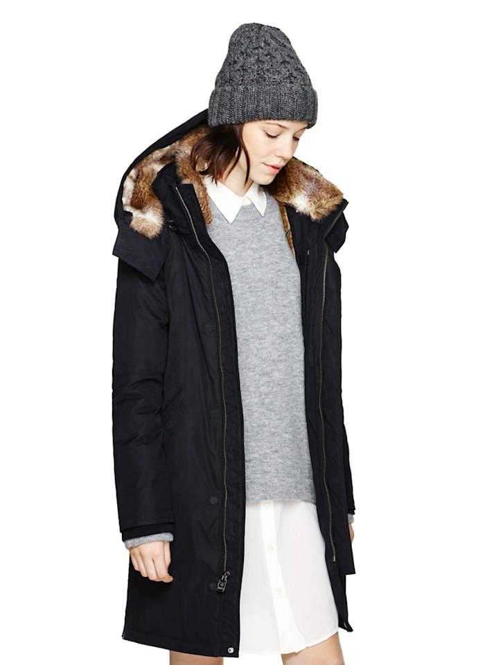 "<p><a rel=""nofollow"" href=""http://www.aritzia.com/en/product/chamonix-parka/49363.html?dwvar_49363_color=1274"">This super stylish parka</a> is filled with 100 per cent polyester and made with water repellant and wind resistant twill black fabric, available in all sizes. The outer shell is polyester and nylon and can stand up to intense Canadian snowstorms. This parka is super warm yet lightweight with a faux-fur lining. There is a handy media pocket, earphone loops, and the removable hood trim is also faux-fur so you and the coyotes can breath a sigh of relief. </p>"