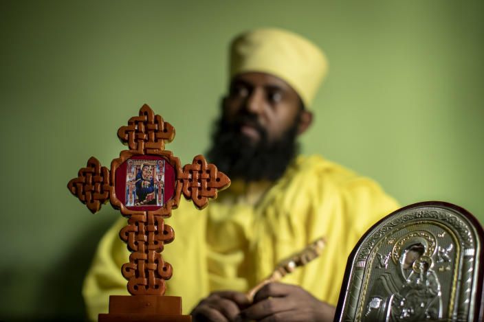 "Ethiopian Orthodox Church priest Aba Yosief Desta, who hopes young people will shun ethnic-driven politics which he calls ""the source of all problems"", speaks to The Associated Press at his office in Gondar, in the Amhara region of Ethiopia Sunday, May 2, 2021. Ethiopia faces a growing crisis of ethnic nationalism that some fear could tear Africa's second most populous country apart, six months after the government launched a military operation in the Tigray region to capture its fugitive leaders. (AP Photo/Ben Curtis)"