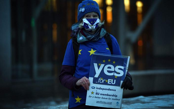 An independence protestor outside the Scottish Parliament last week - AFP