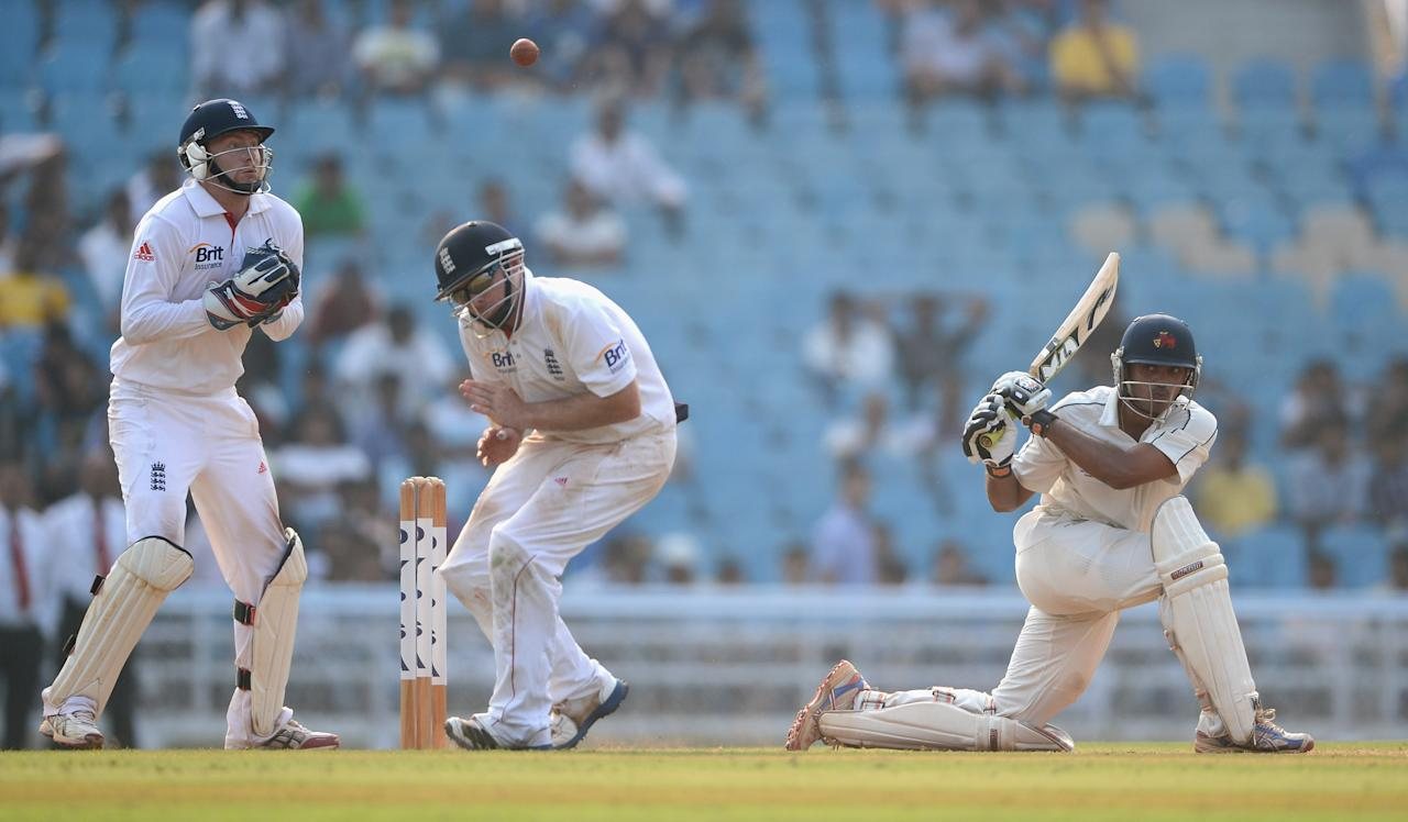 MUMBAI, INDIA - NOVEMBER 04:  Hiken Shahof Mumbai A hits past Ian Bell and Jonathan Bairstow of England during day two of the tour match between Mumbai A and England at The Dr D.Y. Palit Sports Stadium on November 4, 2012 in Mumbai, India.  (Photo by Gareth Copley/Getty Images)