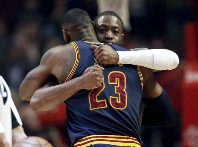 """<a class=""""link rapid-noclick-resp"""" href=""""/nba/players/3708/"""" data-ylk=""""slk:Dwyane Wade"""">Dwyane Wade</a> and <a class=""""link rapid-noclick-resp"""" href=""""/nba/players/3704/"""" data-ylk=""""slk:LeBron James"""">LeBron James</a> have remained close since their Miami breakup. (AP)"""